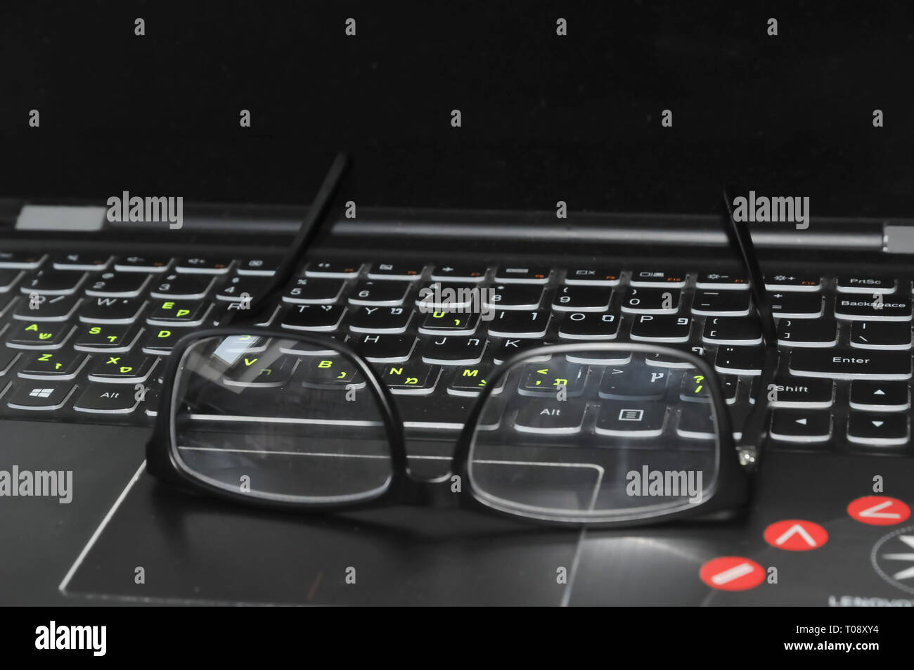 Reading glasses and laptop keyboard - Stock Image