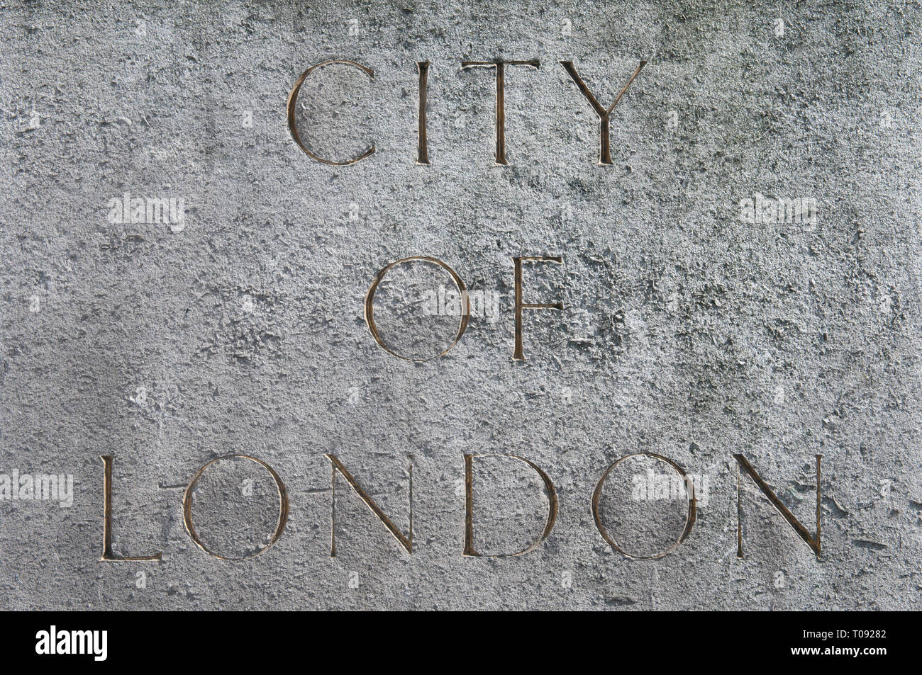 Gold Lettering Carved Into Stone Indicating One Of The Entrances Into The City Of London - Stock Image
