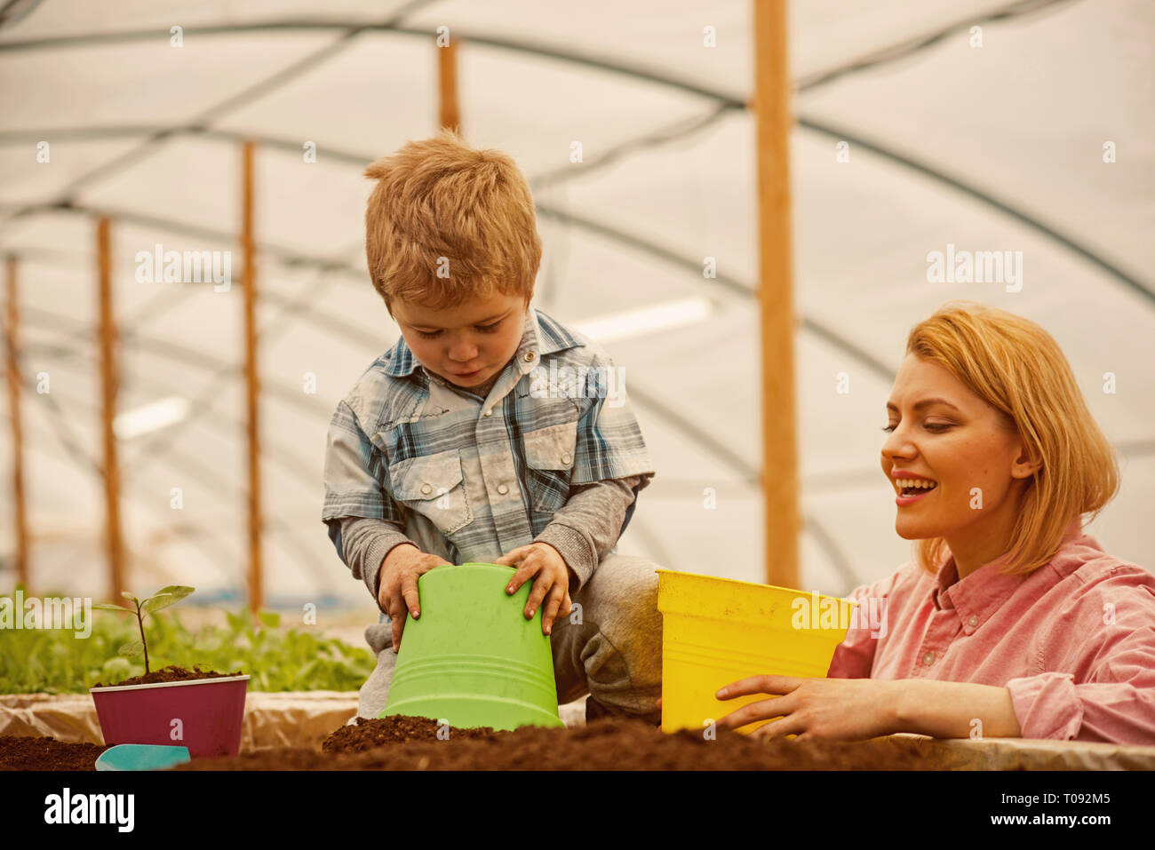 motherhood. happy motherhood with mother and son in greenhouse. motherhood concept. motherhood is a gift to a woman. happy family. - Stock Image