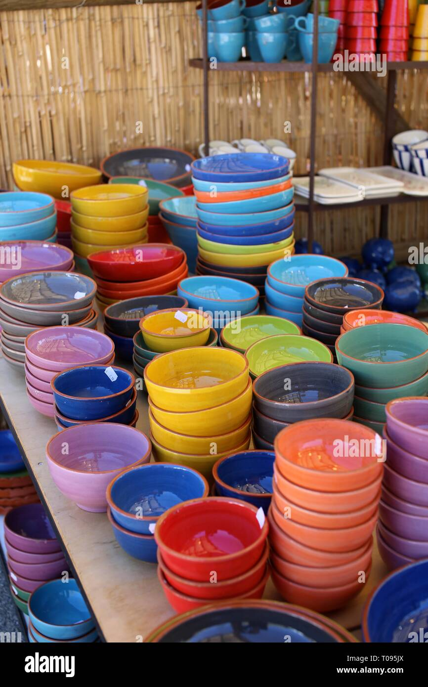 Colourful pottery display at a traditional Spanish market - Stock Image
