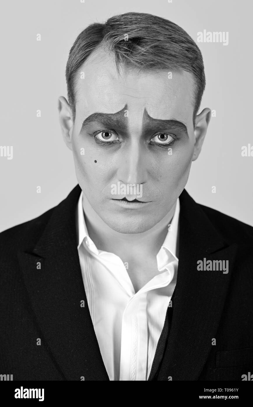 Performing drama. Theatre actor miming. Mime artist. Mime with face paint. Man with mime makeup. Stage actor miming. Theatrical performance art and - Stock Image