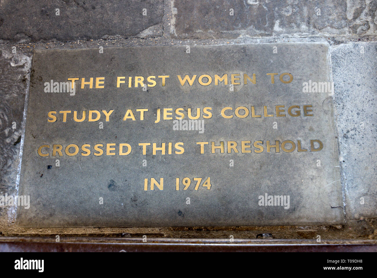 A floor plaque at the entrance,  commemorating the first woman to study at Jesus College on Turl Street in Oxford, Oxfordshire, Britain - Stock Image