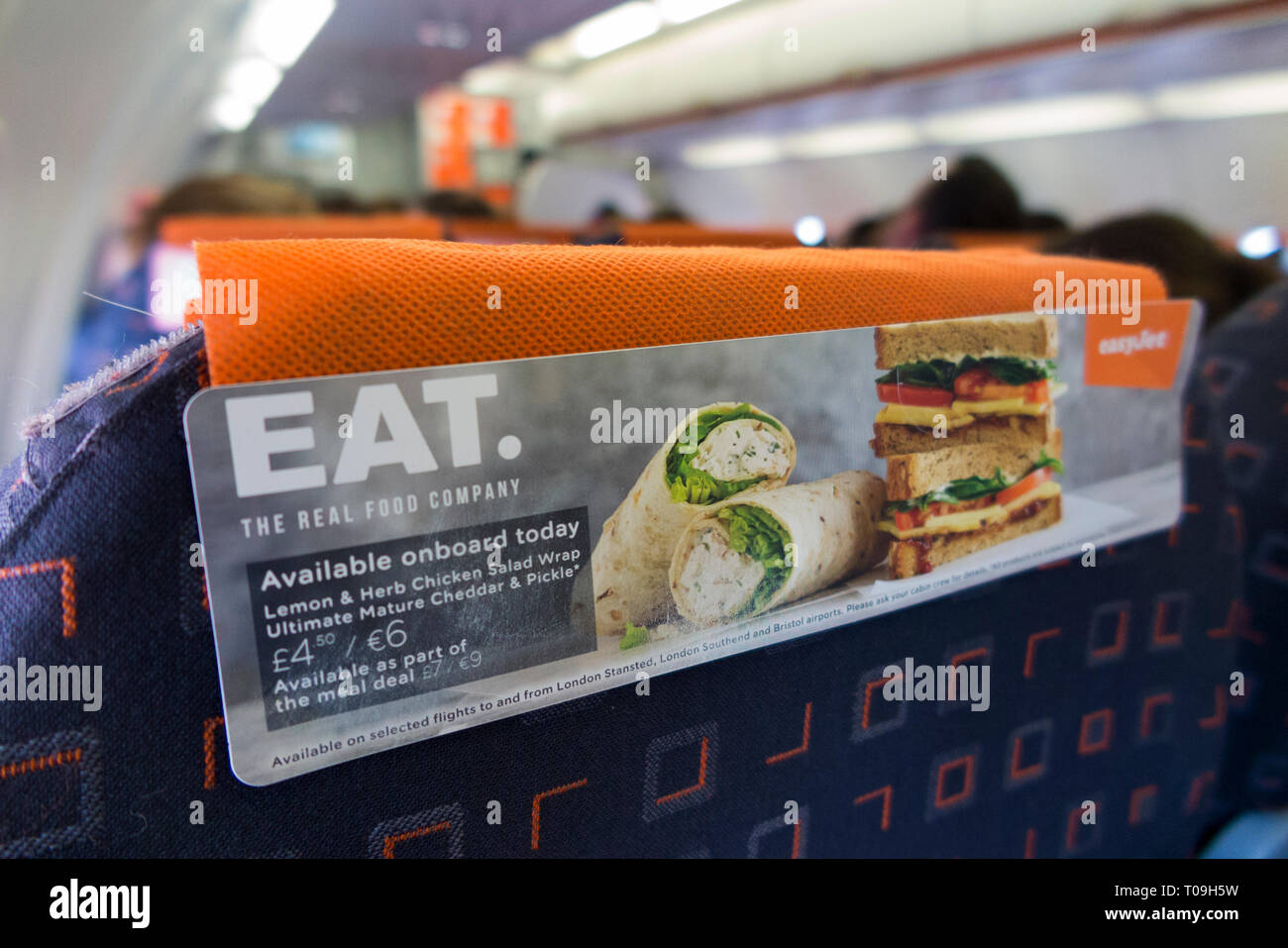 Seat back headrest / head rest / in flight advertising advert promotion for airline snackfood sandwich wrap / wraps for sale to passengers who can buy them on an Easyjet flight. (104) - Stock Image
