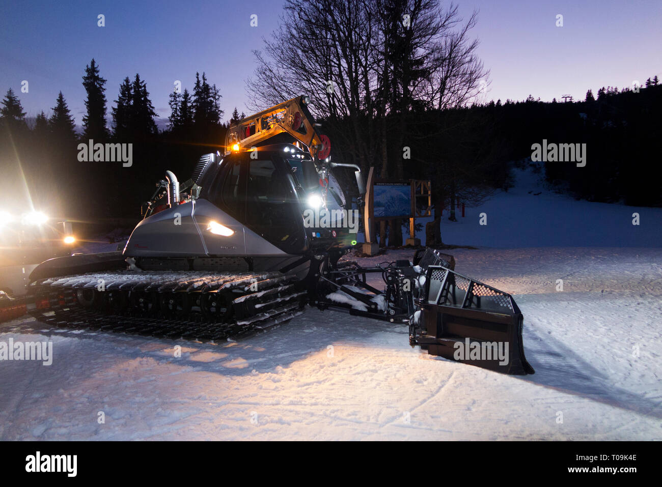 Snow Groomer made by Prinoth Leitwolf crawler ready to prepare the piste / ski slopes at resort Aillons-Margériaz 1600, in France. (104) - Stock Image