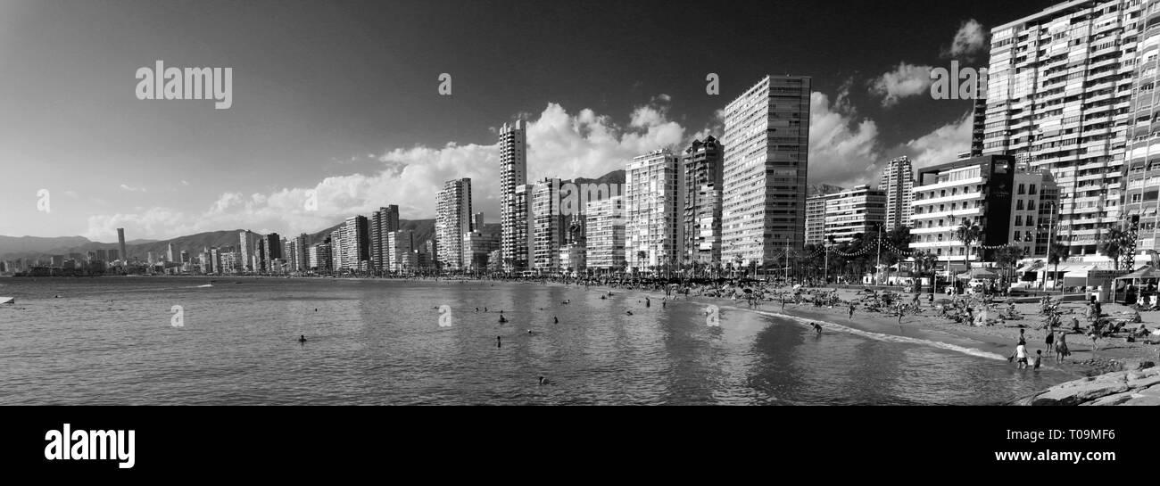 View along the crowded Playa De Levante beach, Benidorm resort, Costa Blanca, Valencia Province, Spain, Europe. - Stock Image