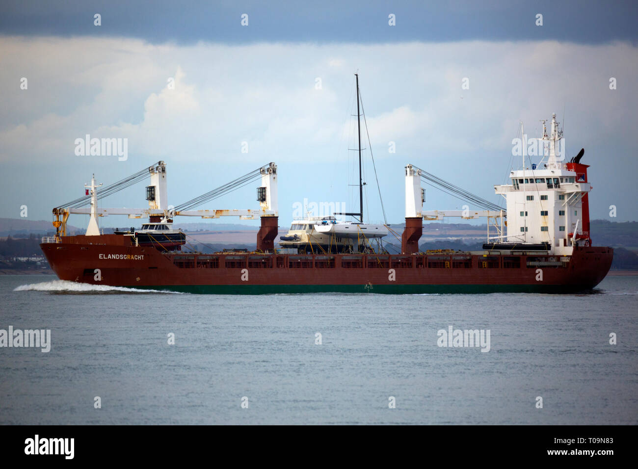 General,Cargo,ship,shipping,Elandsgracht,Amsterdam,Holland,yacht,boat,transport,The Solent,Southampton,Port,Cowes, Isle of Wight, England, UK, - Stock Image