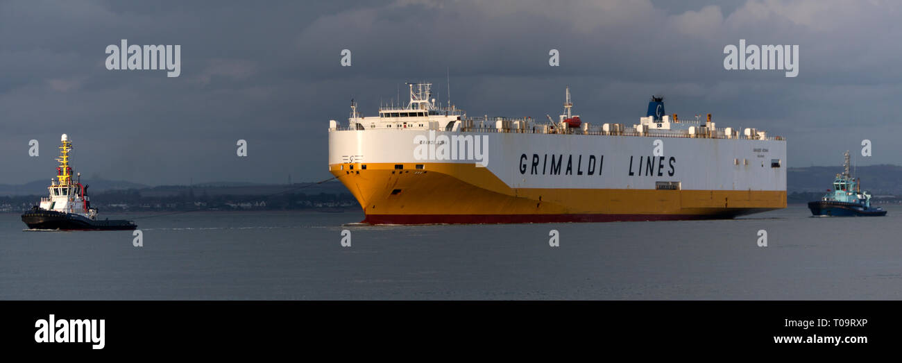 Being towed by tugs, broken down,Car,Grimaldi Lines,Carrier,Grande Roma,Palermo, The Solent,Cowes, to,Southampton,Hampshire,Isle of Wight, - Stock Image