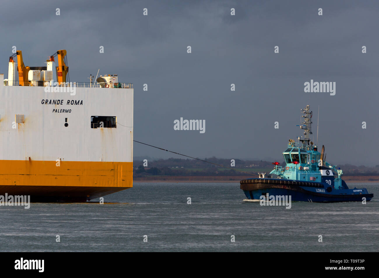 Being towed by tugs, voith,broken down,Car,Grimaldi Lines,Carrier,Grande Roma,Palermo, The Solent,Cowes, to,Southampton,Hampshire,Isle of Wight, - Stock Image