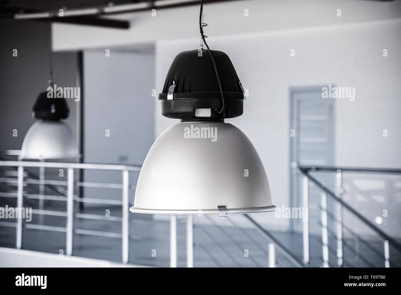 Metal lighting fixtures with a shallow depth of field stock image