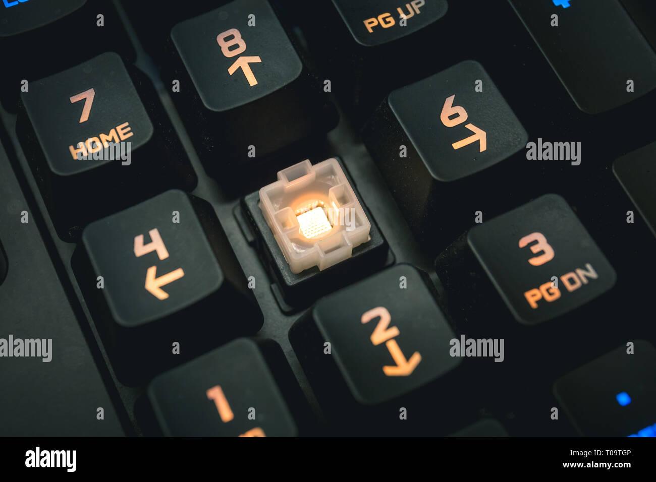 Backlit mechanical keyboard numerical buttons detail shot. - Stock Image