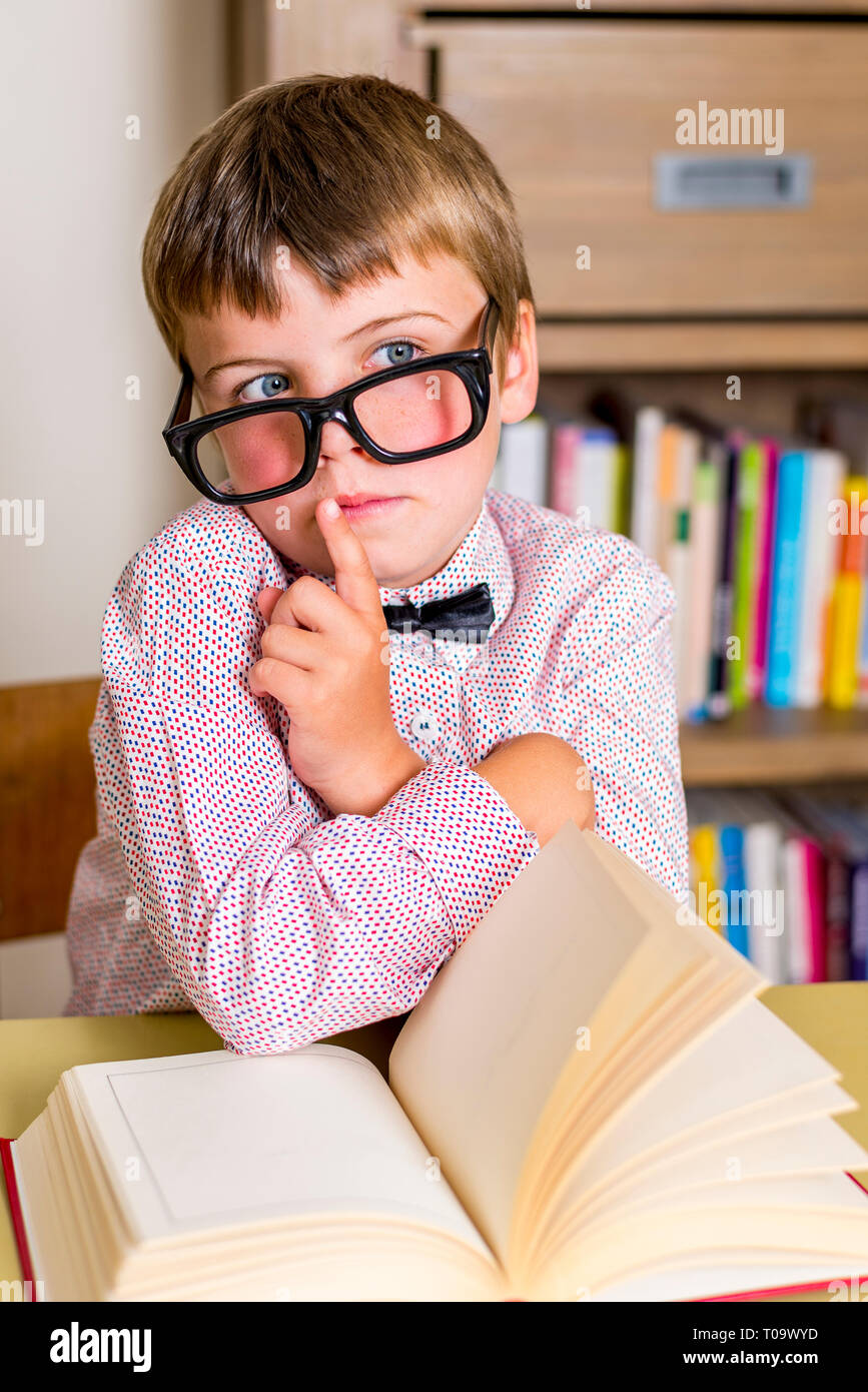 little nerdy boy with geeky goggles,doing silent gesture - Stock Image