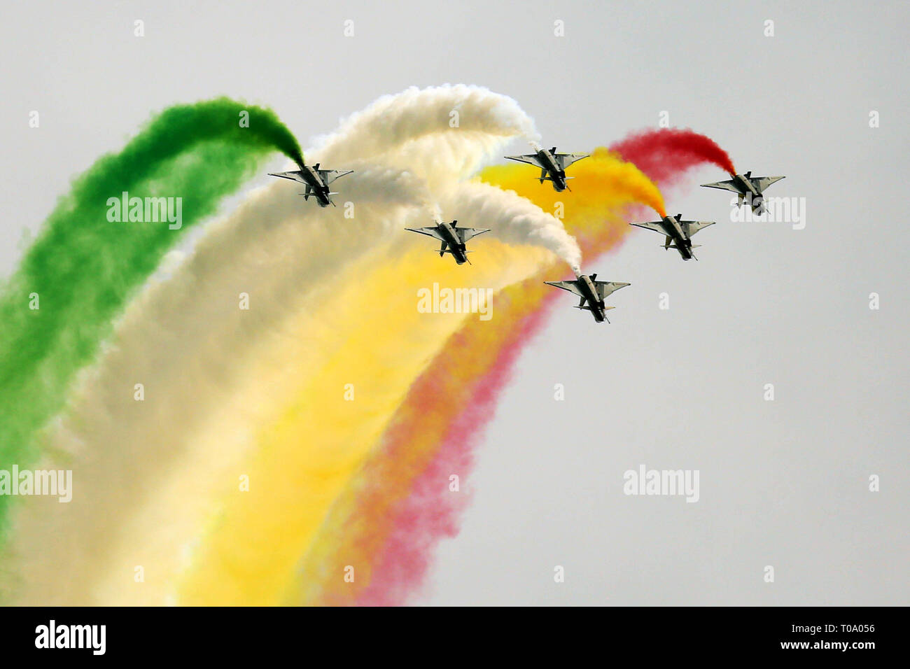 Islamabad, Pakistan. 18th Mar, 2019. J-10 fighter jets of China's Bayi Aerobatic Team perform during the rehearsal of the Pakistan National Day army parade in Islamabad, capital of Pakistan, March 18, 2019. Pakistan National Day, also known as Pakistan Resolution Day or Republic Day, is celebrated annually on March 23. Credit: Ahmad Kamal/Xinhua/Alamy Live News - Stock Image