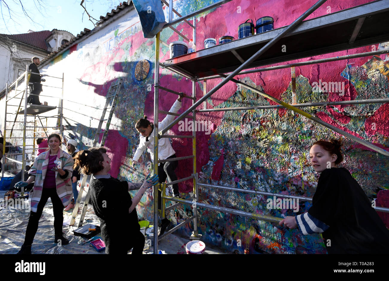 Prague, Czech Republic. 18th Mar, 2019. Start of celebrations of 30 years of free enterprise in the Czech Republic. 20 artists create joint work, Meet Art, measuring 150 square metres on Lennon Wall, Velkoprevorske namesti, Prague, Czech Republic, on Monday, March 18, 2019. Credit: Michal Krumphanzl/CTK Photo/Alamy Live News - Stock Image