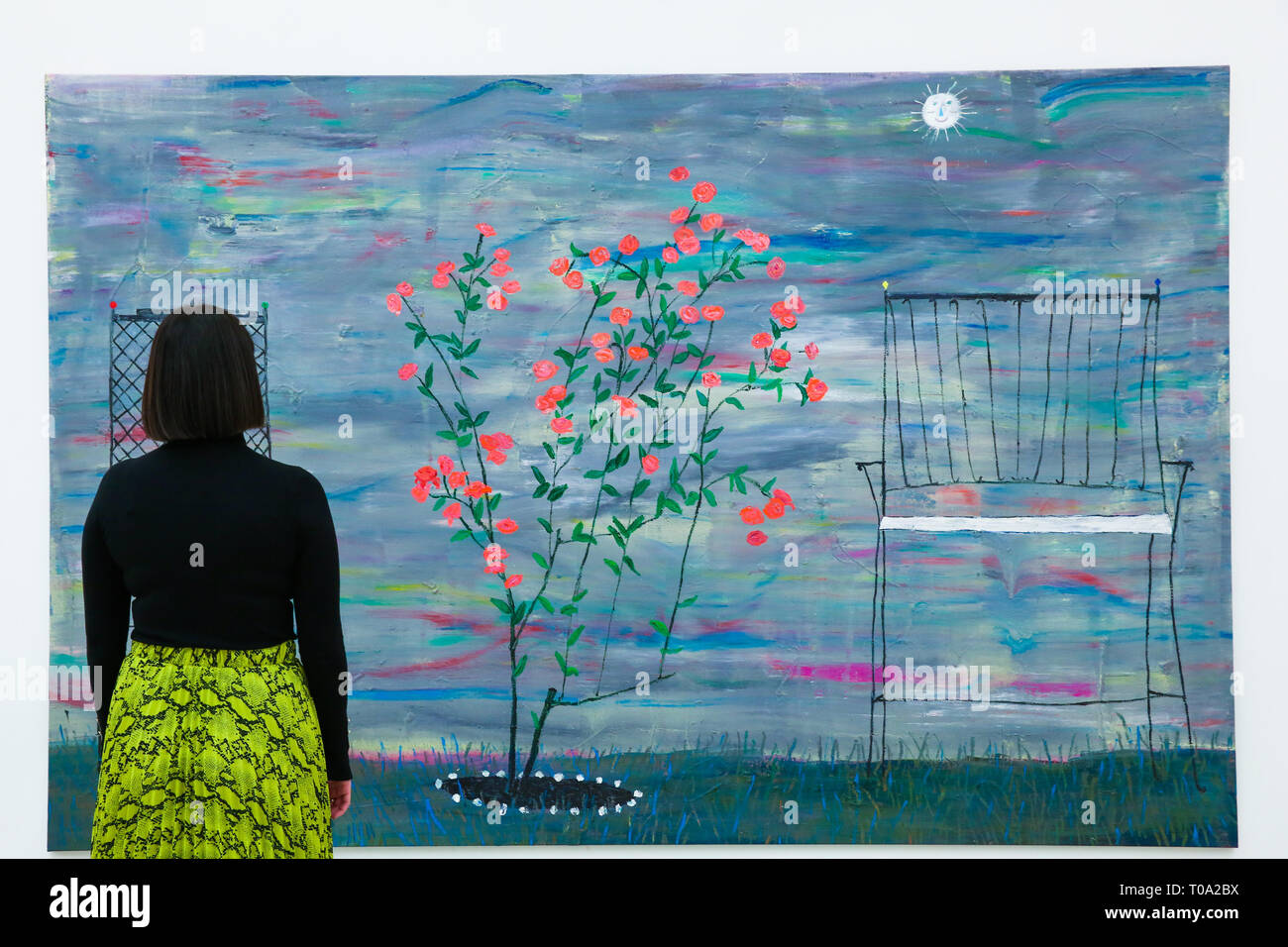 March 14, 2019 - London, UK, United Kingdom - A woman is seen viewing Tom Howse's ''Rosebush'' at Saatchi Gallery during the exhibition. .Kaleidoscope at the Saatchi Gallery presents is an exhibition featuring the work of 9 international contemporary artists working across a variety of mediums which aims to be a timely exploration of our relationship with our surroundings, asking everyone to reconsider the way we engage with our environment. Kaleidoscope runs until 5 May 2019. (Credit Image: © Dinendra Haria/SOPA Images via ZUMA Wire) Stock Photo