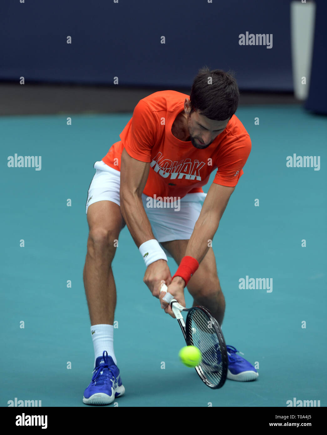 Miami Gardens, Florida, USA. 18th Mar 2019.Novak Djokovic on the practice court prior to the start of the Miami Open Tennis Tournament at Hard Rock Stadium. Novak Djokovic is a Serbian professional tennis player who is currently ranked world No. 1 in men's singles tennis by the Association of Tennis Professiona on March 18, 2019 in Miami Gardens, Florida.  People: Novak Djokovic Credit: Storms Media Group/Alamy Live News - Stock Image