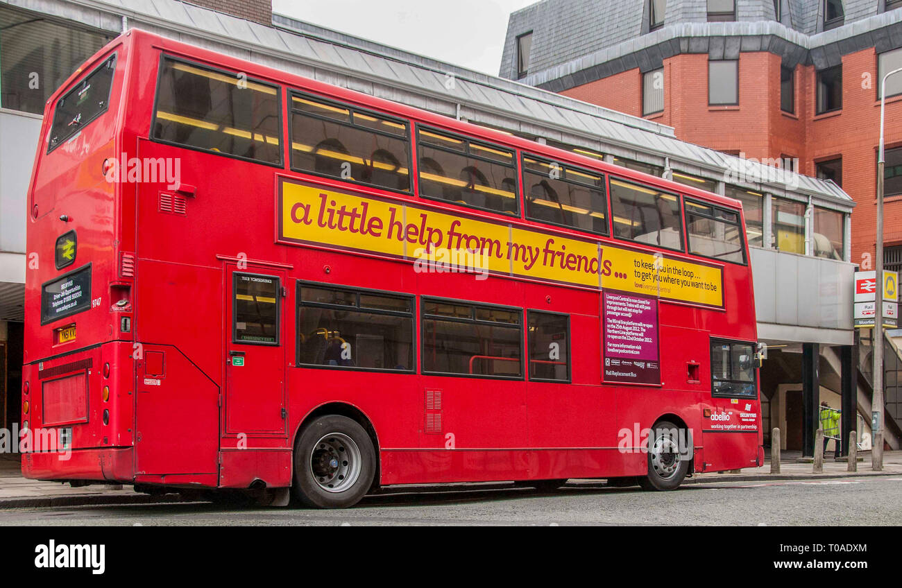 Merseytravel and Merseyrail replacement bus service Red Bus Double decker - Stock Image