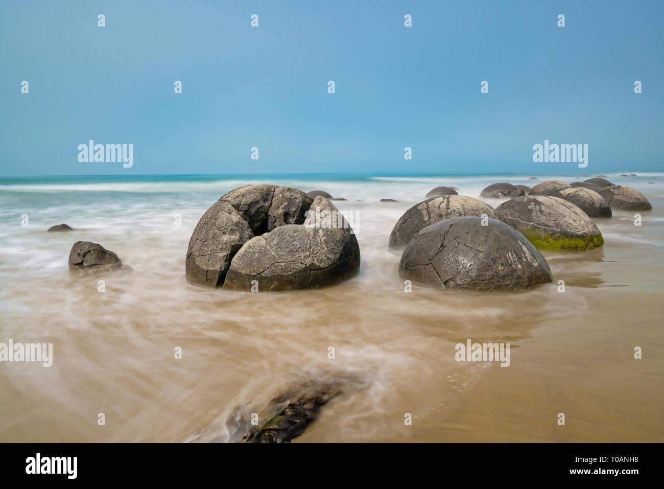 Moeraki Boulders on Koekohe Beach natural wonder and tourist attraction on coastal South Island New Zealand - Stock Image