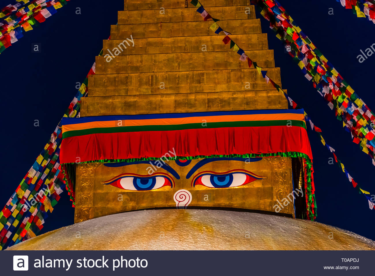 The Boudhanath Stupa which contains the Eyes of Buddha, which symbolizes Buddha as all seeing. The Boudhanath Temple is the  largest stupa in Nepal an - Stock Image