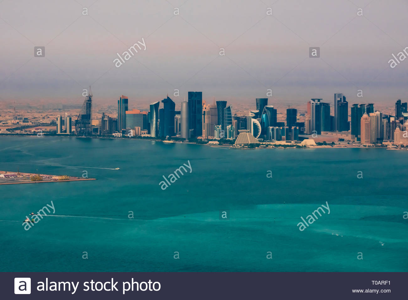 Aerial view of skyscrapers lining the Cornice, the waterfront promenade in Doha, Qatar in the Persian Gulf. - Stock Image