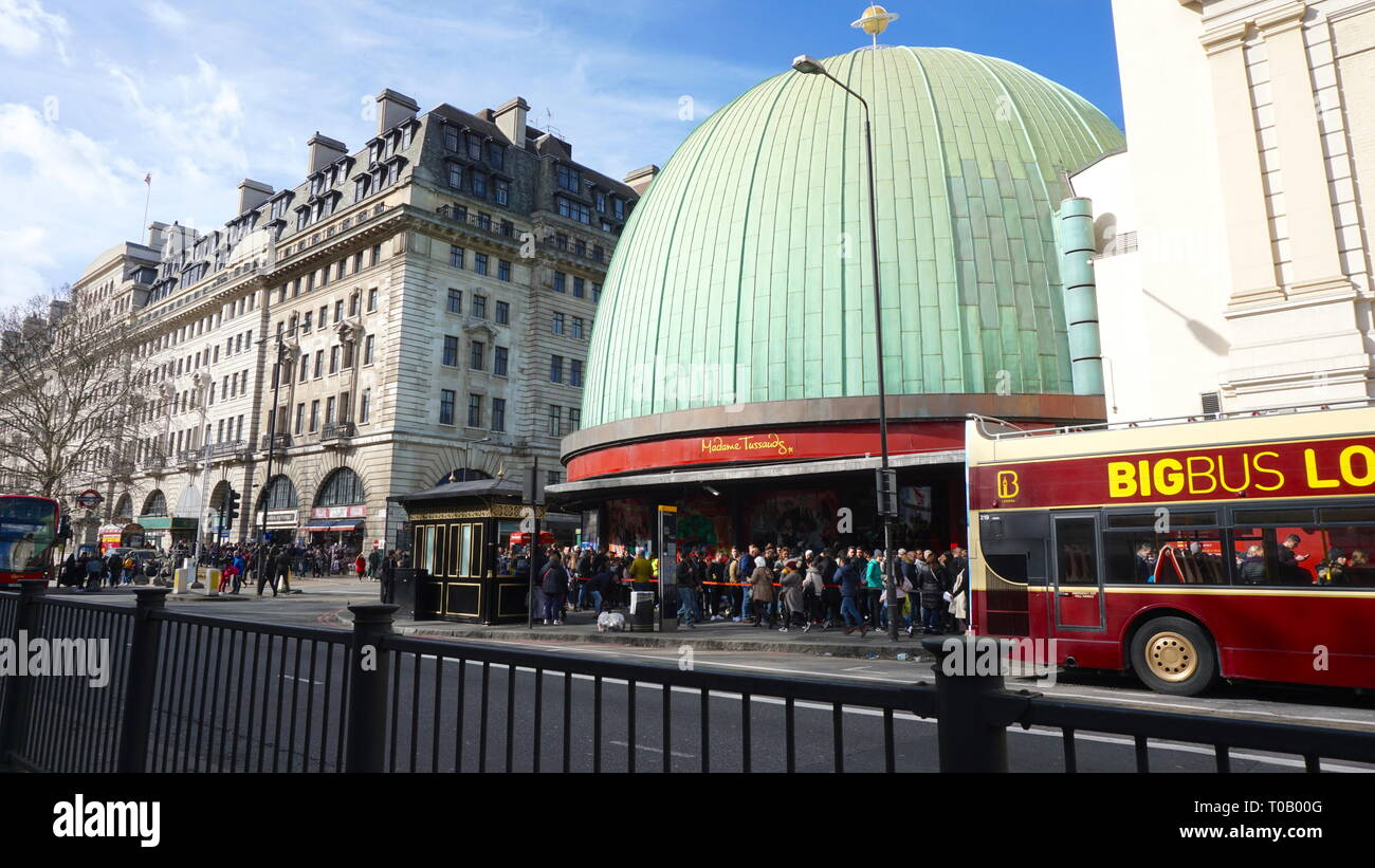Tourists forming queue outside Madame Tussauds London. United Kingdom - Stock Image