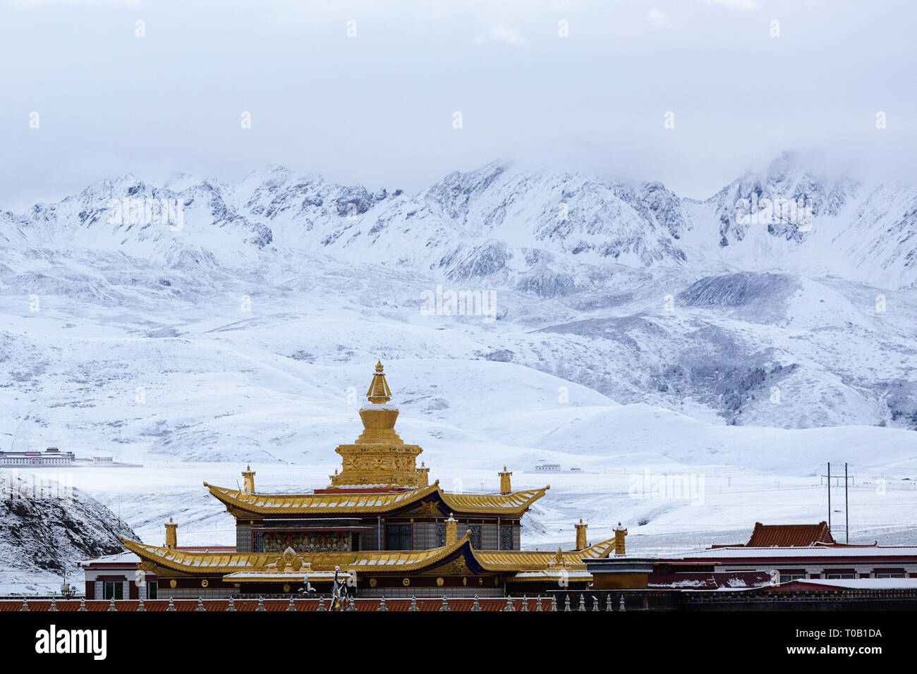 Tagong Temple on the Tagong Grassland in Ganzi Prefecture, Sichuan Province in snow covered landscape - Stock Image