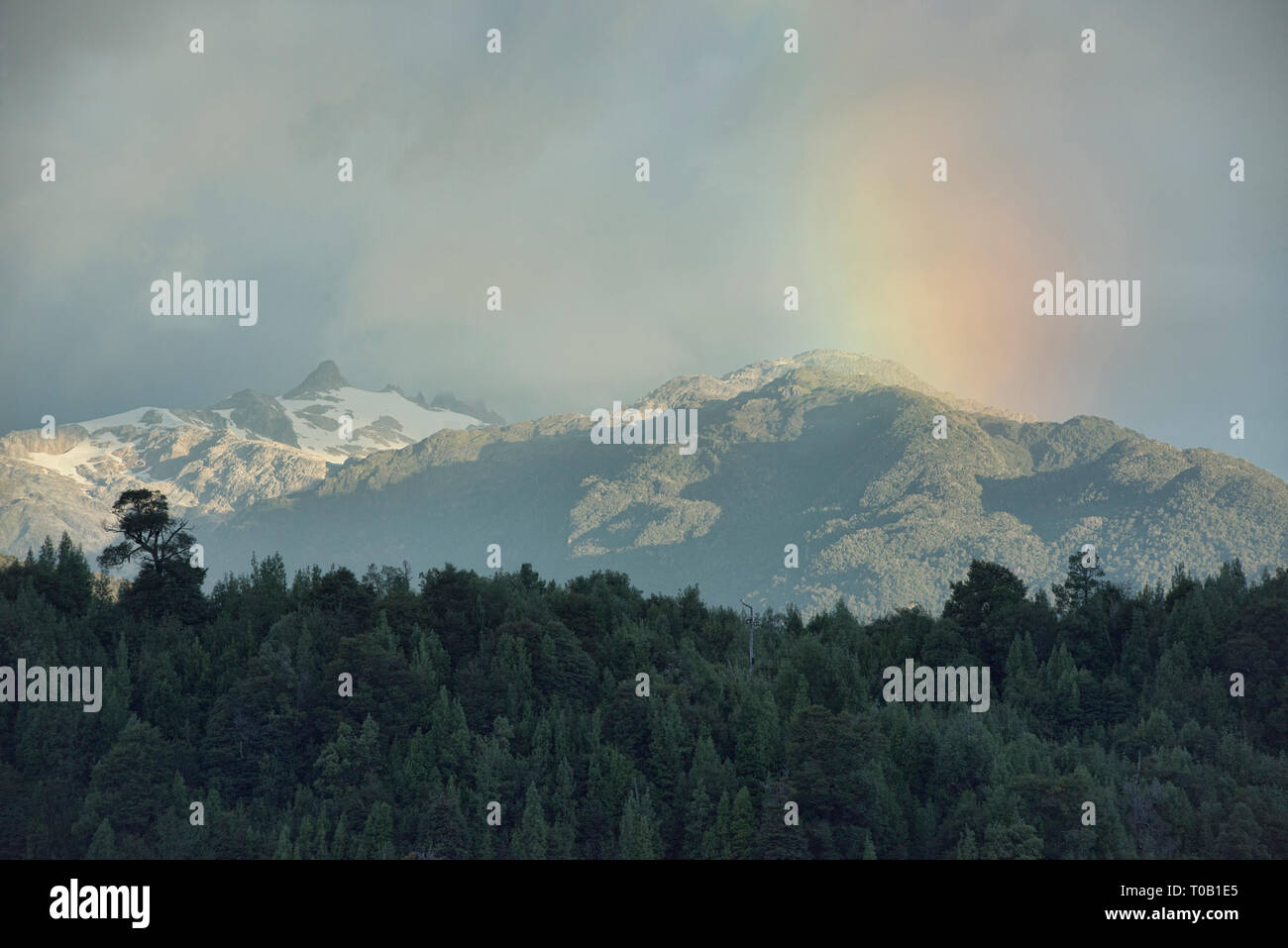 Rainbow over Queulat National Park and Puyuhuapi fiord, Patagonia, Aysen, Chile - Stock Image