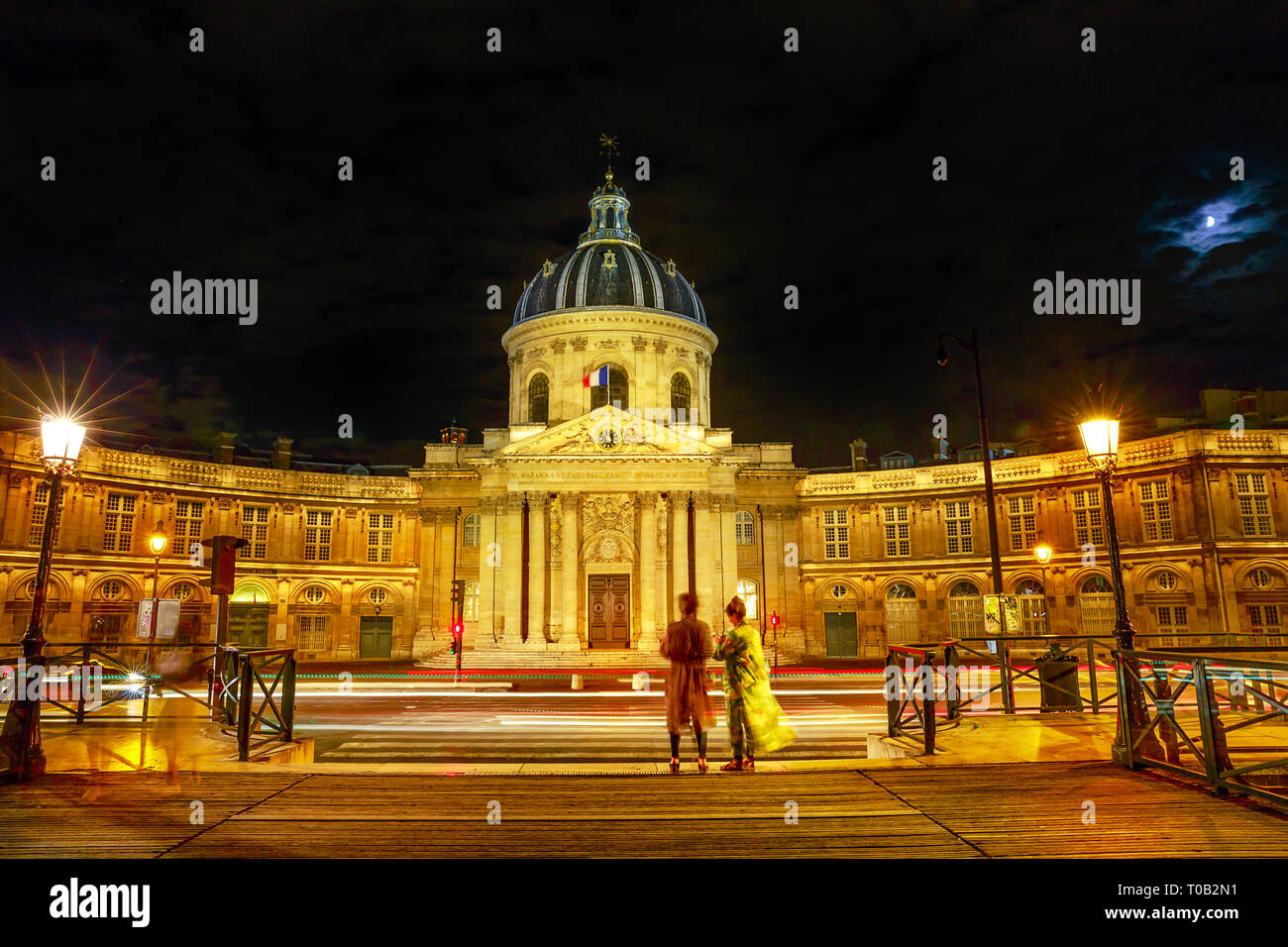 Paris, France-July 1,2017:Pont des Arts bridge to Institut de France building, a French learned society group of five academies. Crossing bridge point - Stock Image