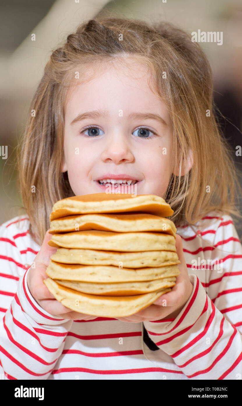 Pancake Day, Asda Livingston, Eileen Hillary Bakery Staff and Isla cawkwell 4 east calder. - Stock Image