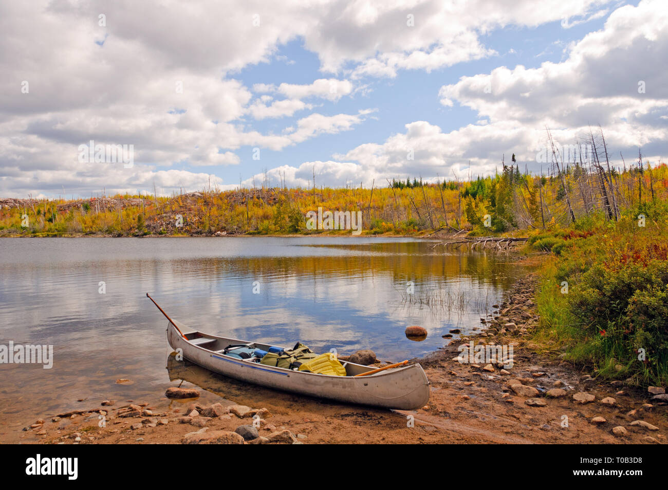 Canoe Ready for unloading at the Seagull Lake Portage - Stock Image
