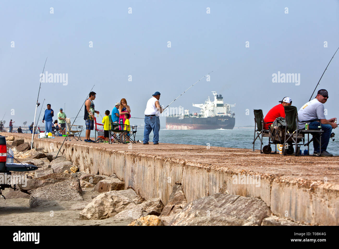 Families with young children,  fishermen,  fishing at Port Aransas Jetty,  Port Aransas Jetty which extends south into the Gulf Of Mexico. - Stock Image