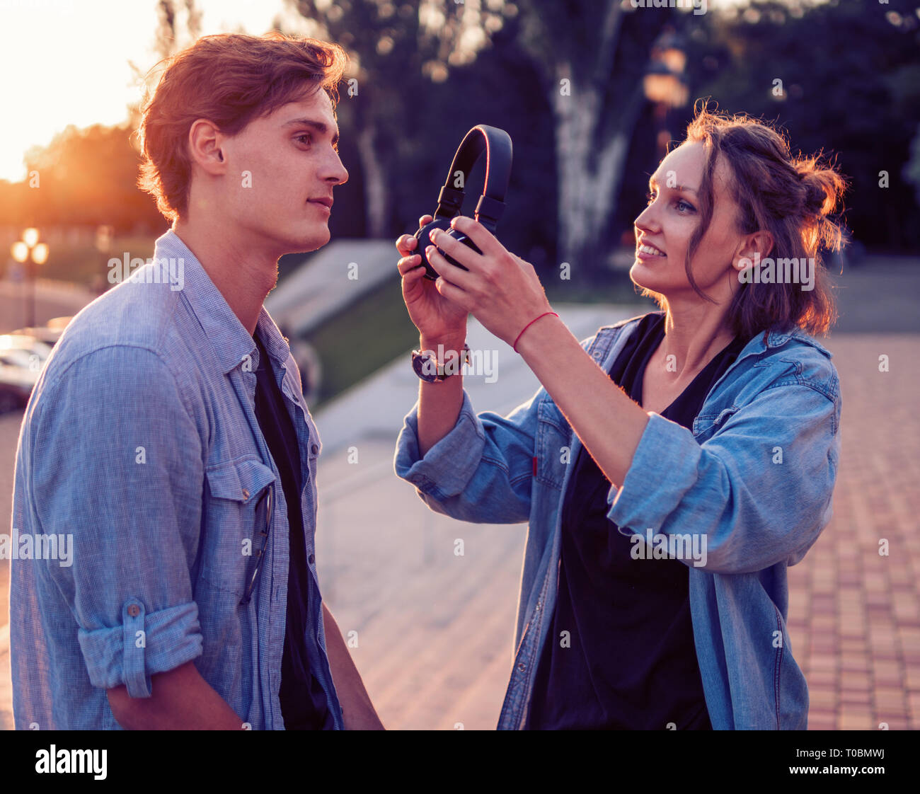 Lovely young hipster couple dating during summer sunset. Stock Photo