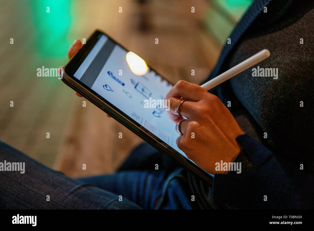 woman drawing on digital tablet with stylus pencil. Stock Photo