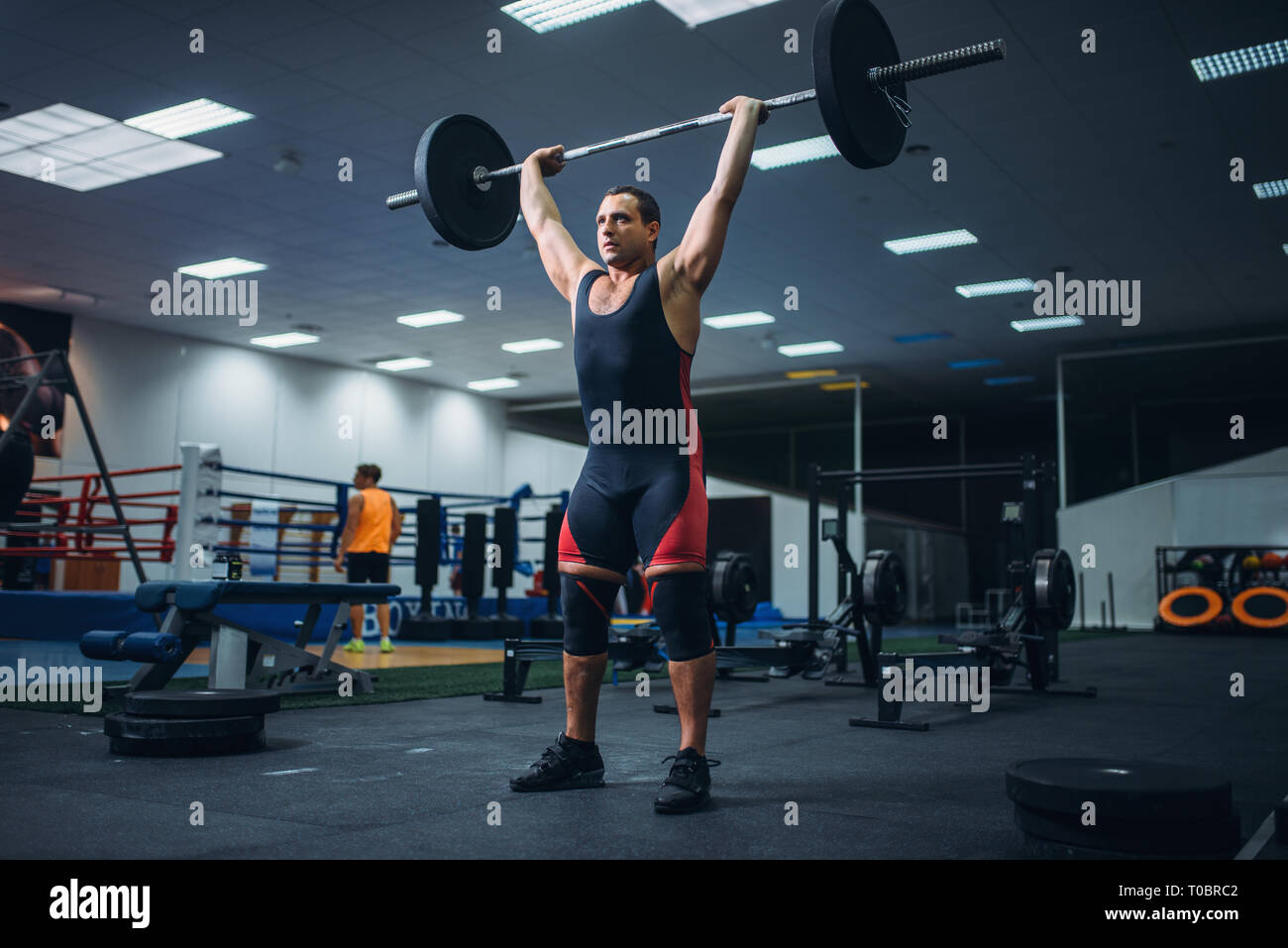 a38a16ce8ea6 Strong male powerlifter doing deadlift a barbell in gym. Weightlifting  workout