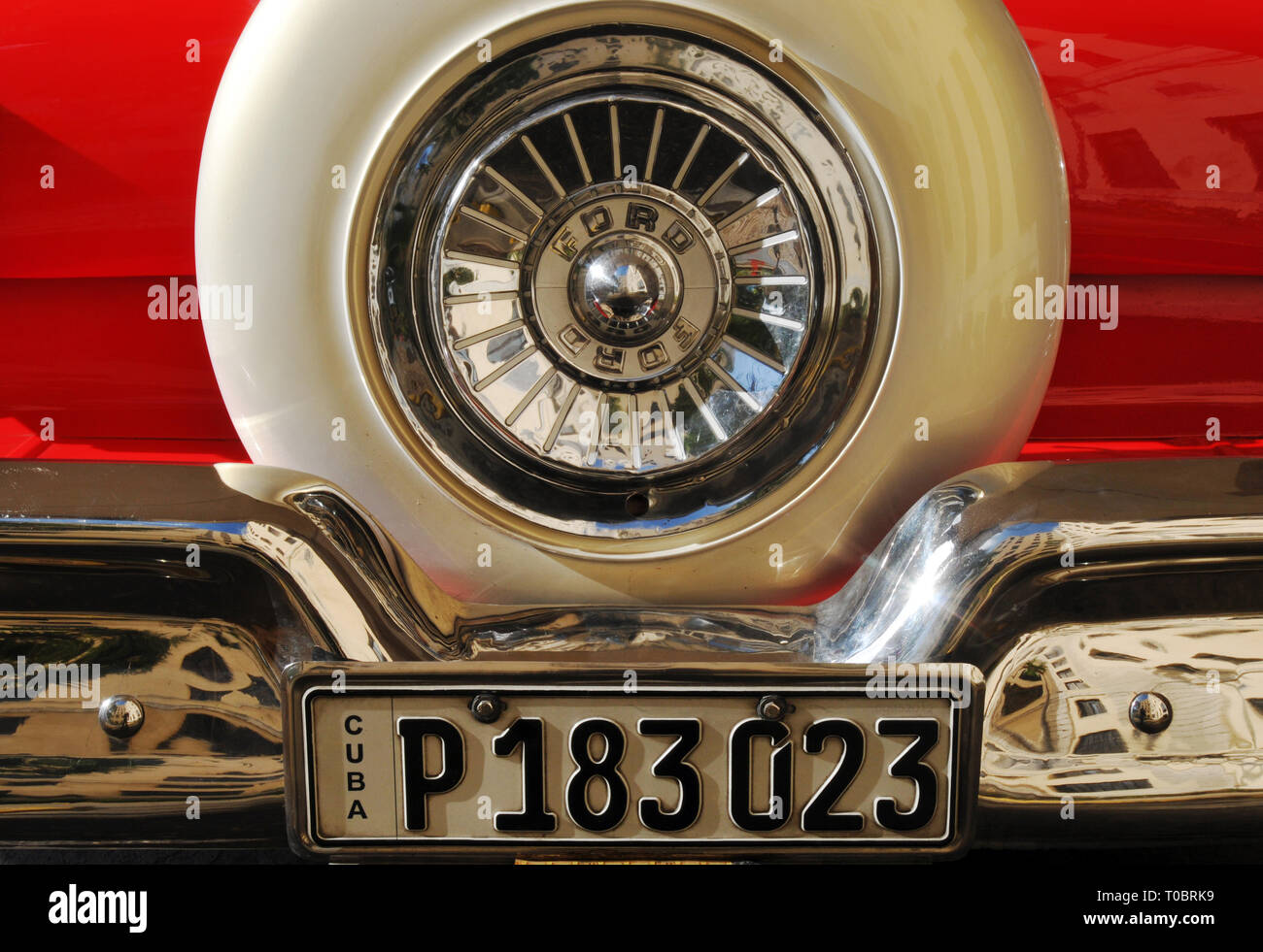 Detail of the spare tire mounted at the back of a classic Ford automobile in Havana, Cuba. - Stock Image
