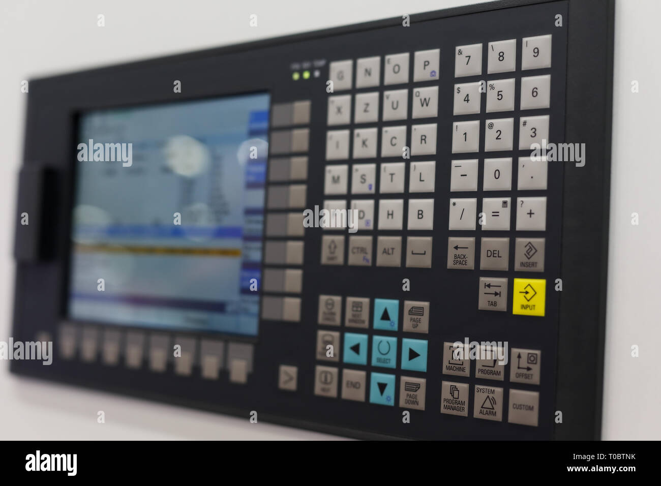 Control panel and screen of CNC-operated machine. Selective focus. - Stock Image