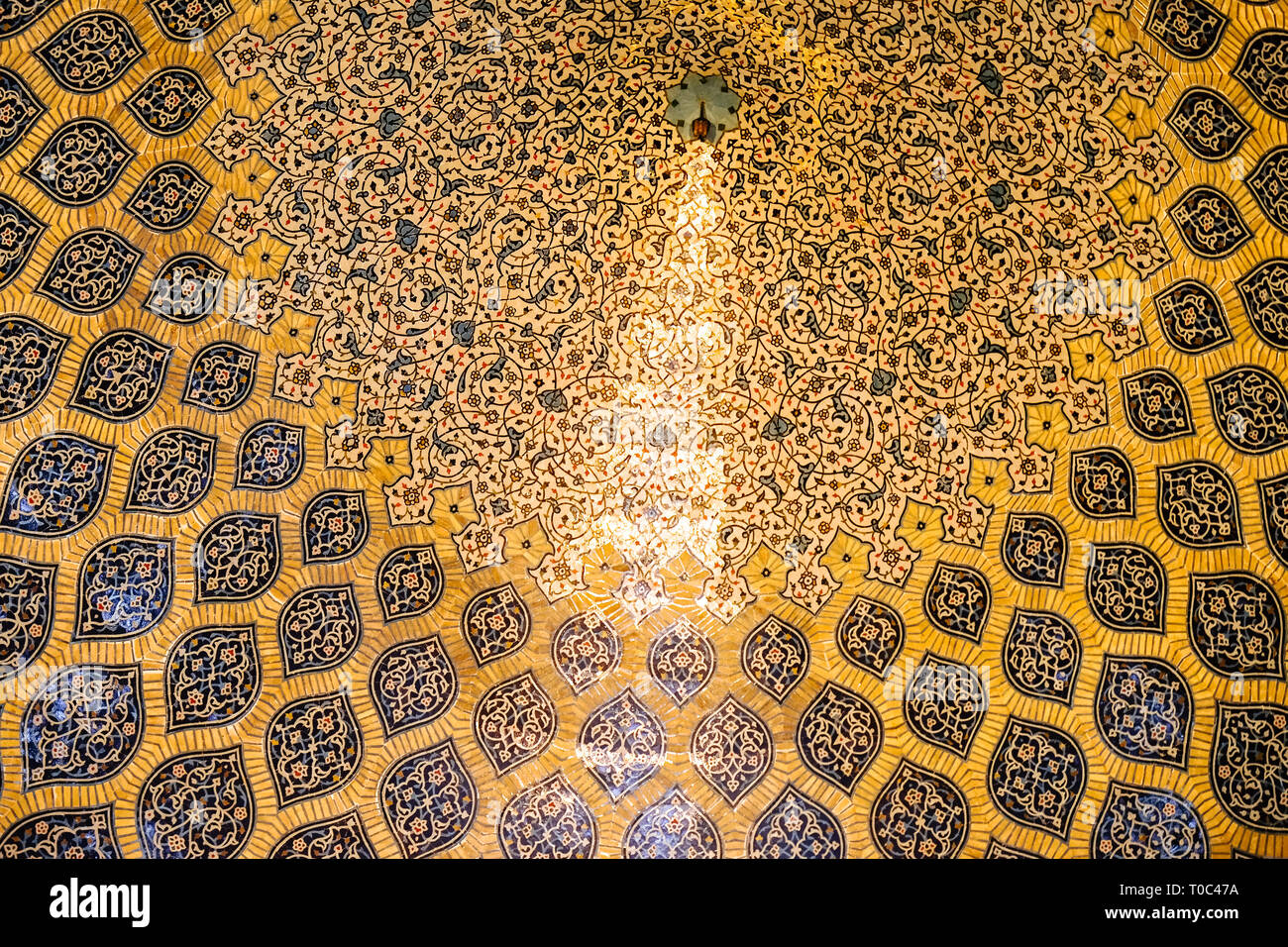 Isfahan, Iran. October 30, 2016 : Sun rays scattered to the rings of ornamental bands forming peacock-like shape. Sheikh Lotfollah Mosque. - Stock Image