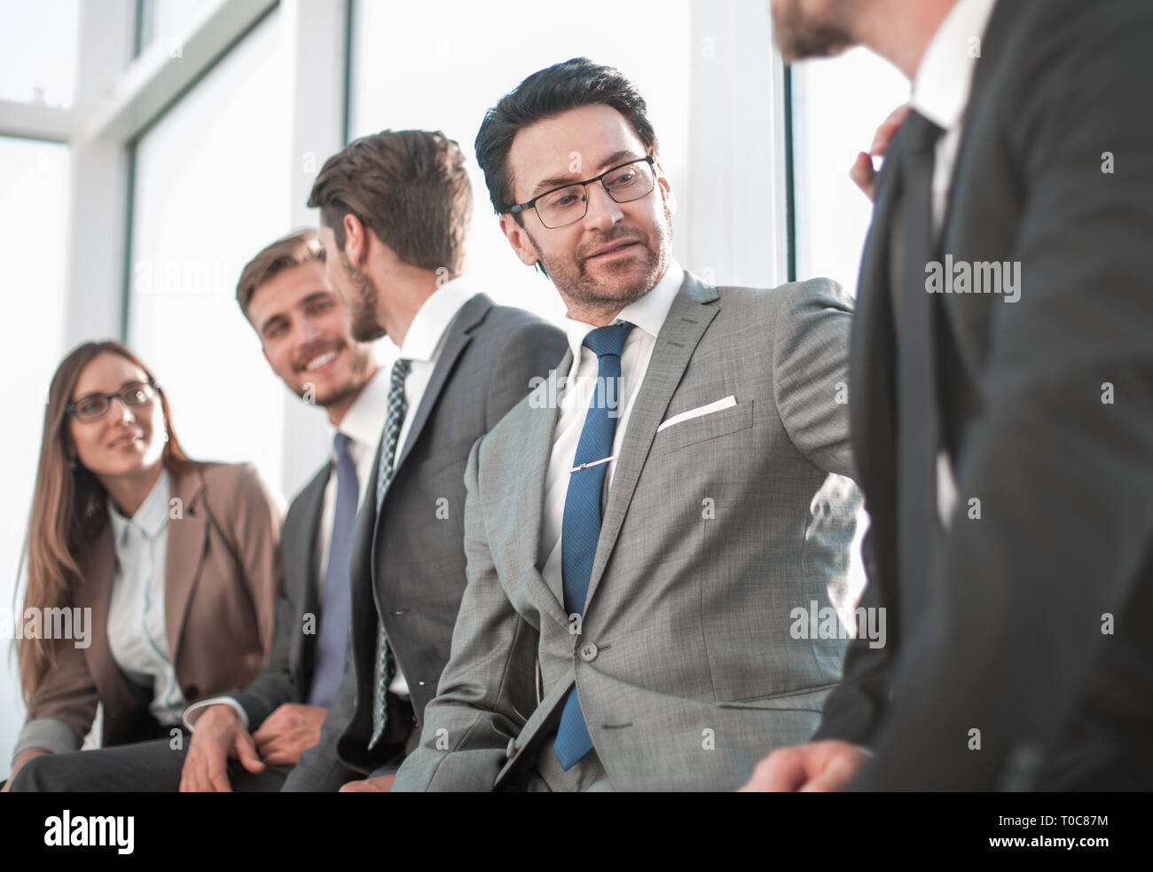 Business people working in an office - Stock Image