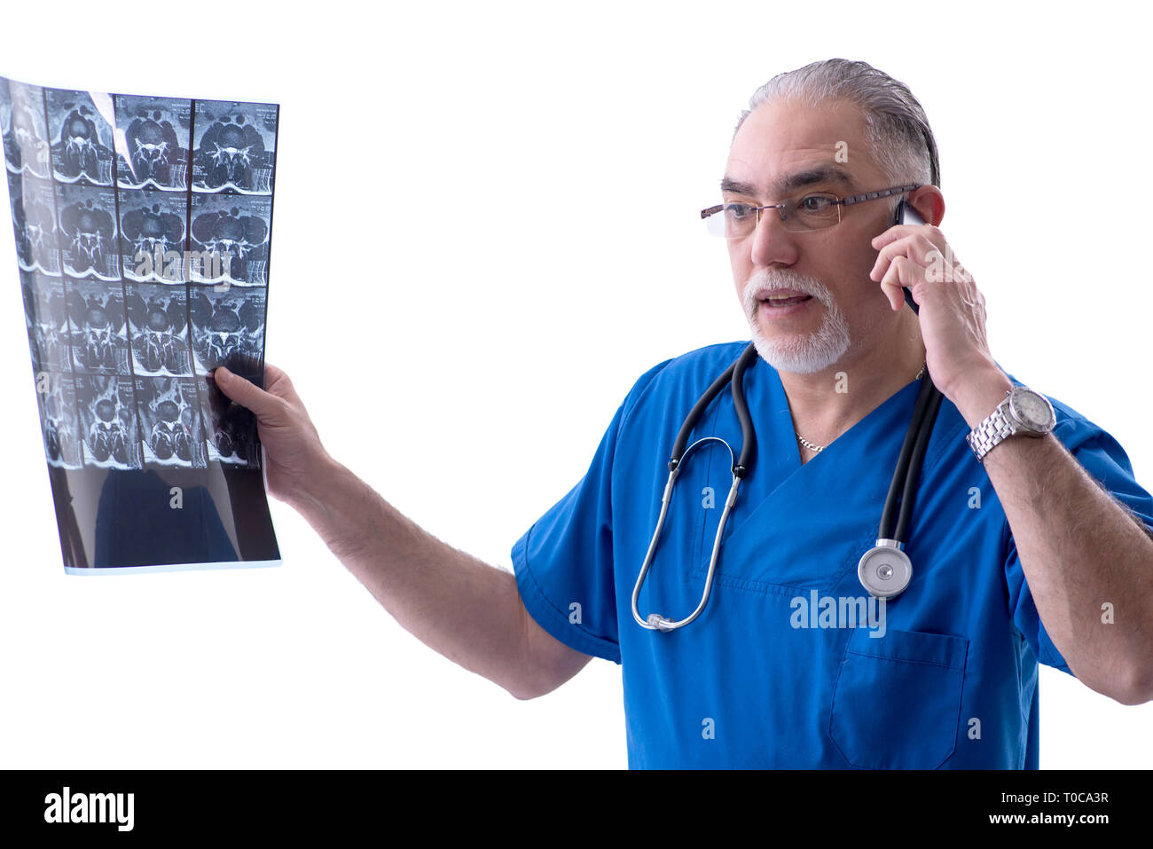 White bearded old doctor radiologist working in clinic - Stock Image