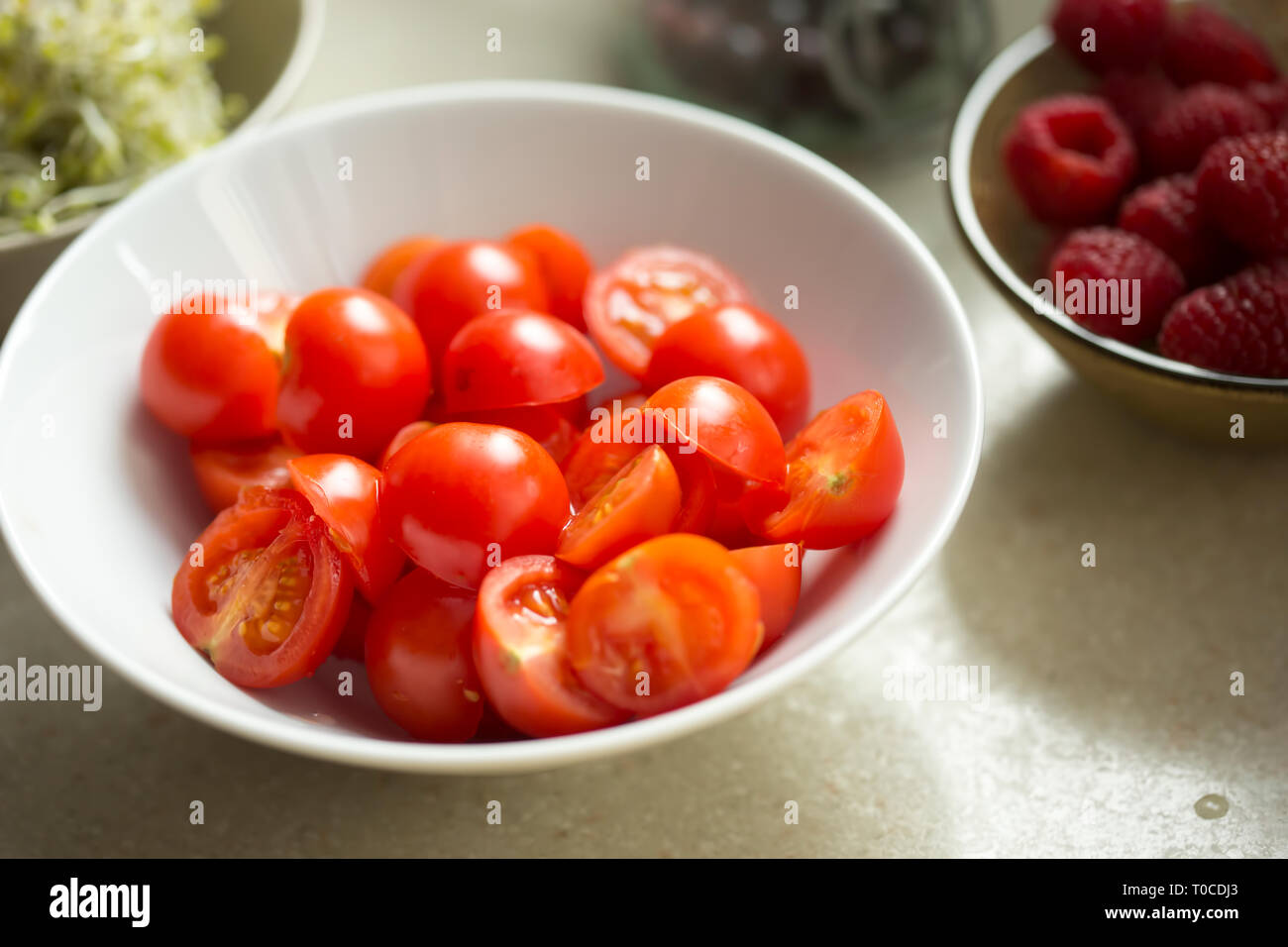 Cherry tomatoes in bowl, salad ingredients Stock Photo