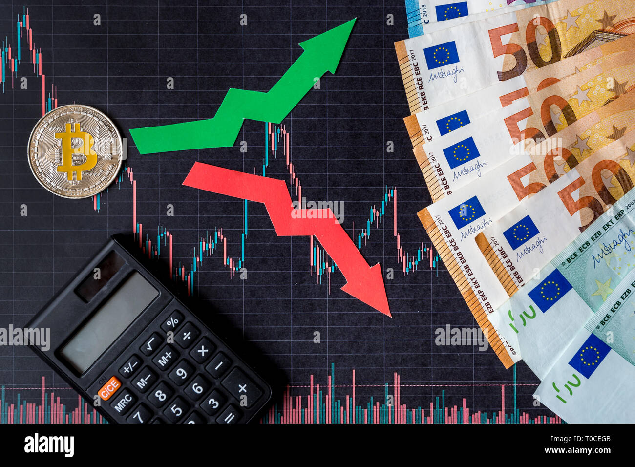 fluctuations  and forecasting of exchange rates of virtual money. Red and green arrows with golden Bitcoin ladder on black paper forex chart backgroun - Stock Image
