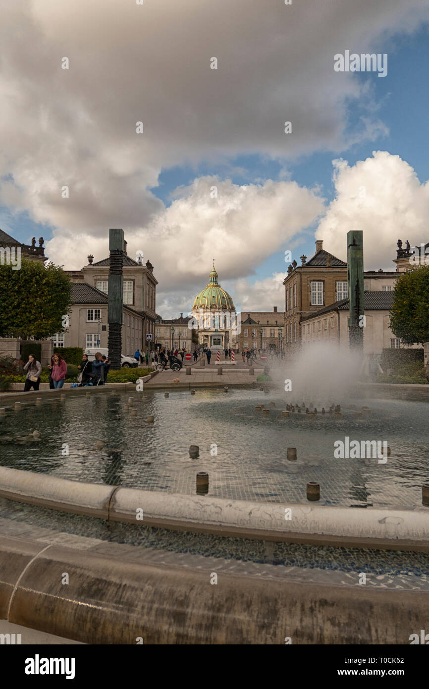 The fountain in Amaliehaven, the Amalienborg Palace and the Marble Church seen from the waterfront in Copenhagen, Denmark - Stock Image