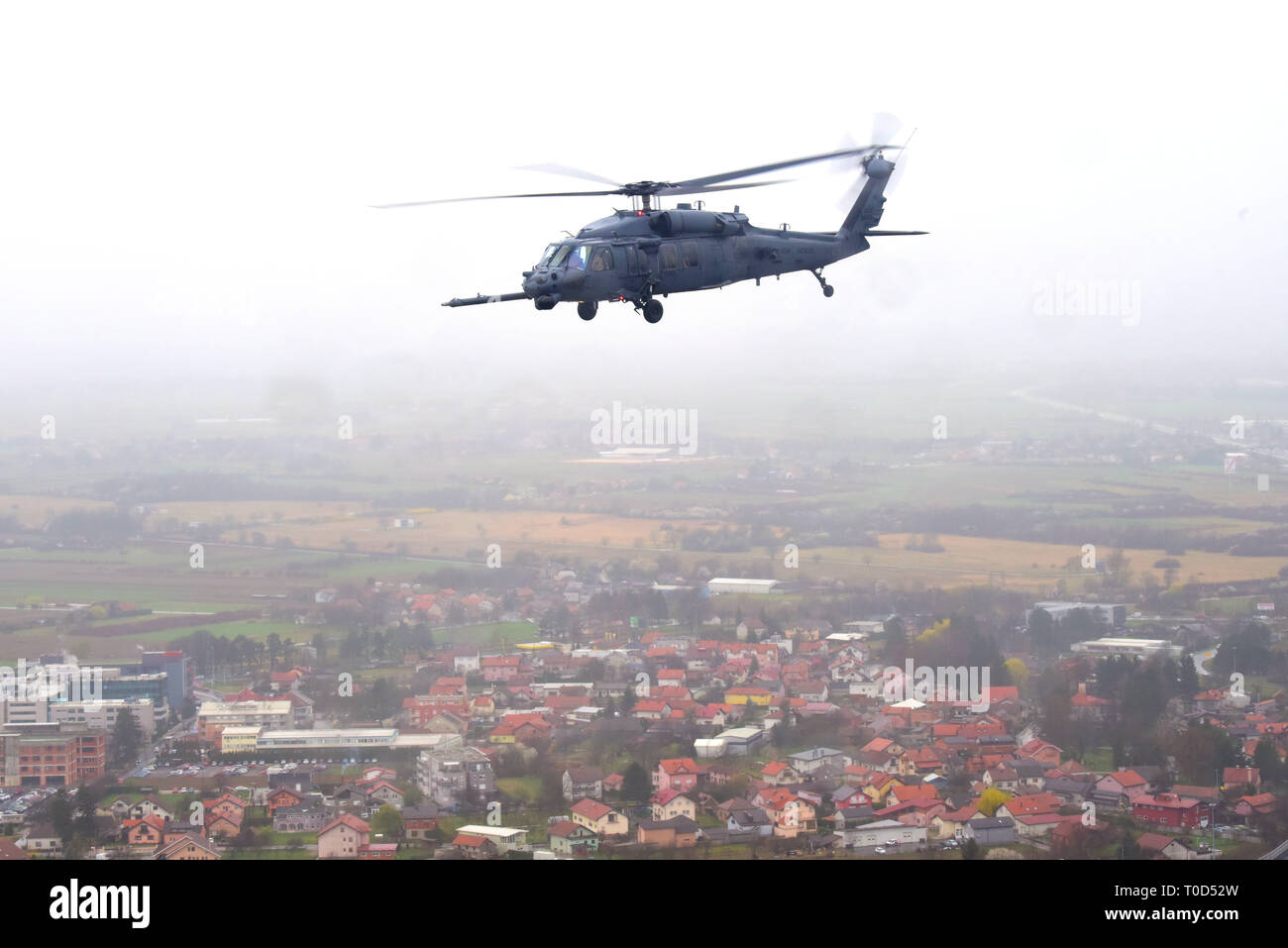 A 56th Rescue Squadron HH-60 Pave Hawk, based out of Aviano Air Base, Italy, transports simulated casualties during a Non-combatant Evacuation Operation exercise near Zagreb, Croatia, March 18, 2019. NEO exercises simulate the ordered or authorized departure of civilians and non-essential military personnel from danger in an overseas country. (U.S. Air Force photo by Senior Airman Kevin Sommer Giron) - Stock Image