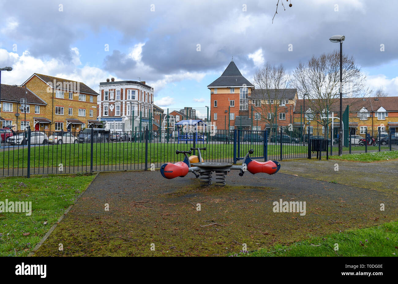 Bermondsey Borough of Southwark London UK - Estate playground with The Bramcote Arms in background which has been converted into flats Stock Photo