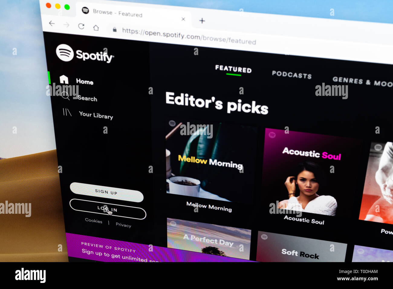 Spotify log in homepage in desktop computer browser, cursor on log in button - Stock Image