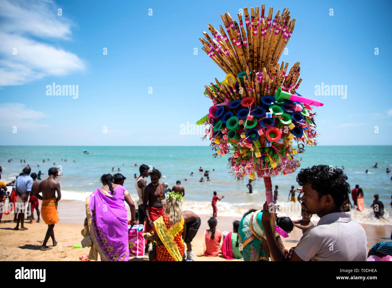 Hawkers selling flutes and candy floss, Kulasekharapatnam beach, Tamil Nadu, India, Asia - Stock Image