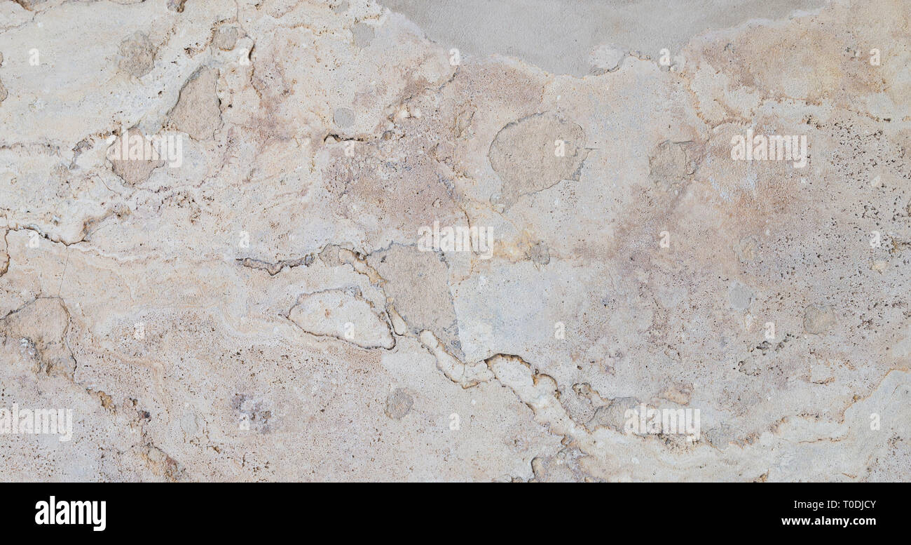 Full frame texture background of a weathered and abstract light brown stone slab. Stock Photo