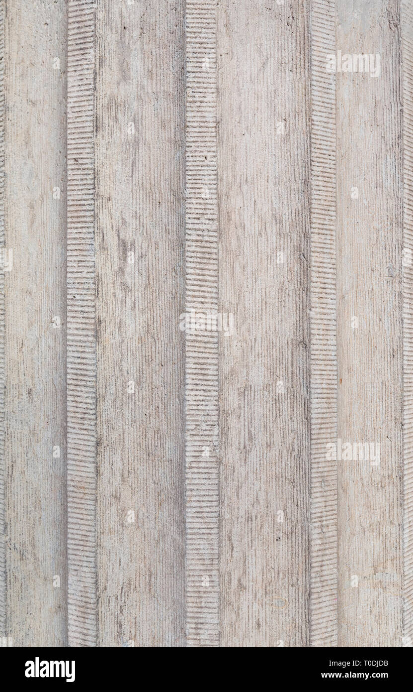 Close-up of a corrugated rough concrete wall, full frame background. Stock Photo