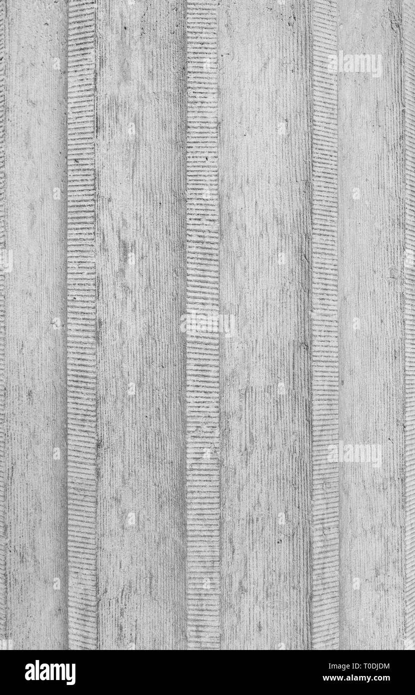 Close-up of a corrugated rough concrete wall in black and white, full frame background. Stock Photo