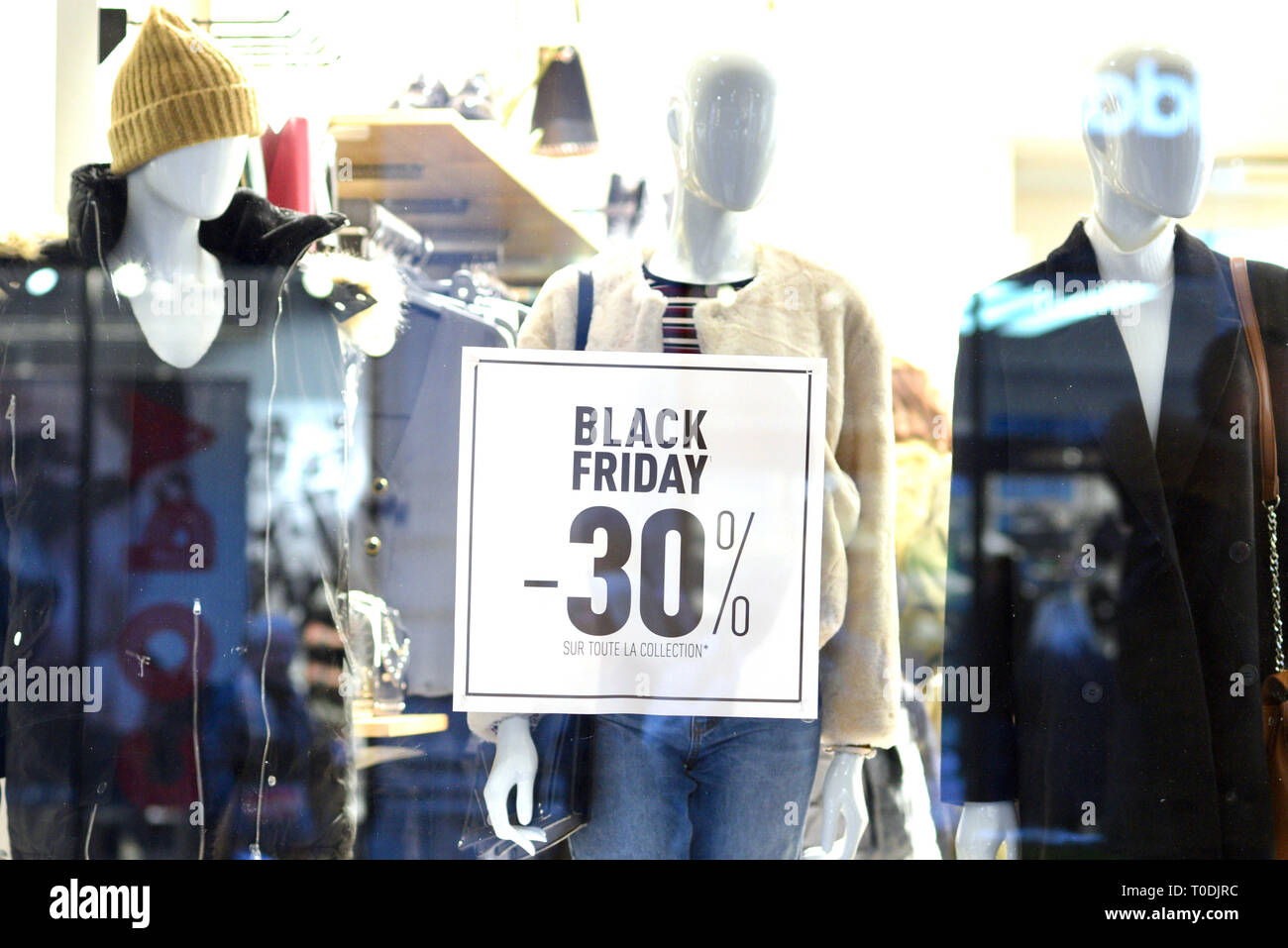 Poster 'Black Friday, 30% off the entire collection' on a shop window on November 23, 2018 - Stock Image