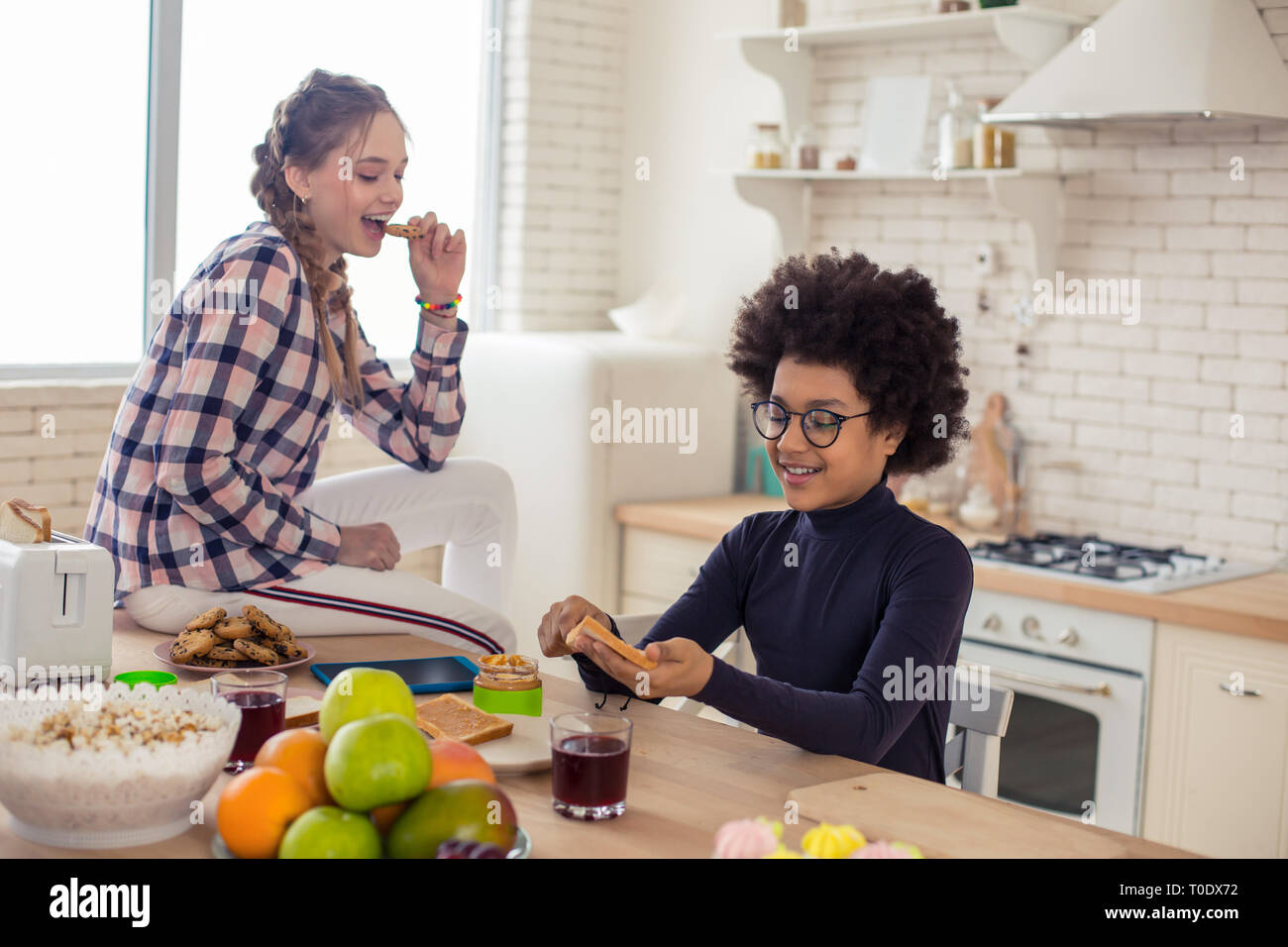 Kind brunette boy enjoying his cooking activity - Stock Image